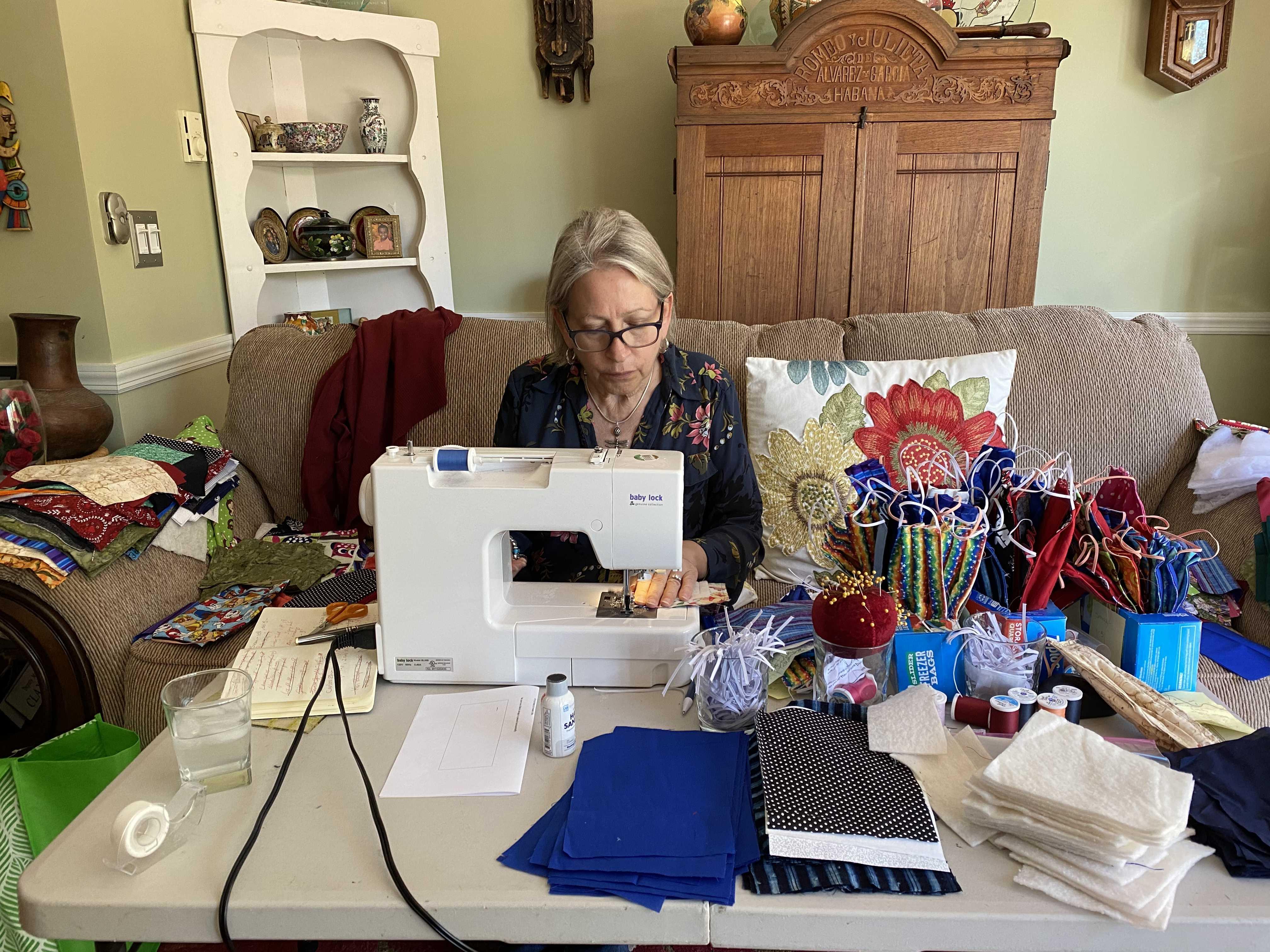 Drew at sewing machine