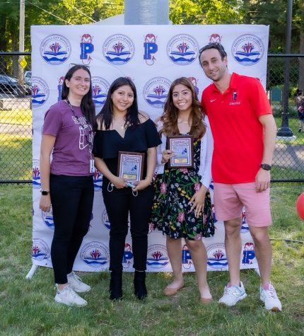 Soccer players Jenna Torres and Hannah Hildago with coaches Stephanie Potts and Troy Lepore.